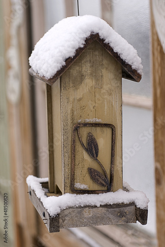 Snow on an Empty Bird Feeder