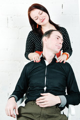 Man receiving shoulder massage from his woman