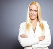 Portrait of attractive blond businesswoman with arms crossed iso