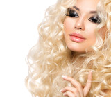 Fototapety Beauty Girl With Healthy Long Curly Hair. Blonde Woman
