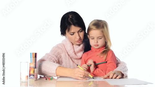 Mother and daughter girl draw together