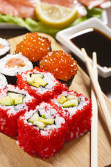Rolls with tobiko, avocado and cucumber
