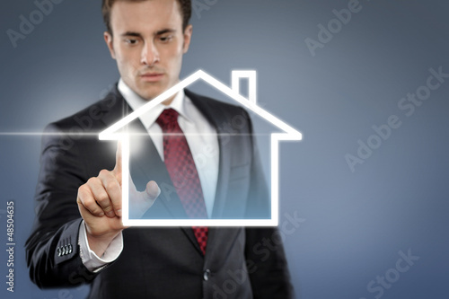 Man with Touchscreen House