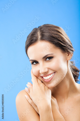 Portrait of beautiful woman, on blue