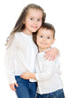 Little girl and boy hugging. Isolated on white