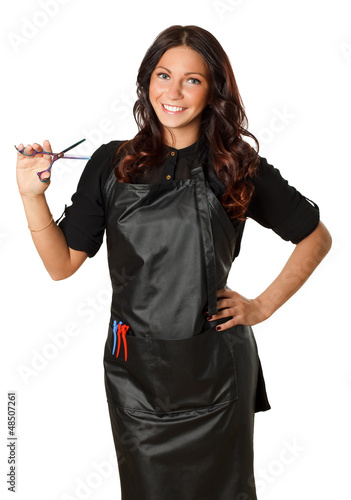 An attractive hairdresser with scissors in hand. Isolated.