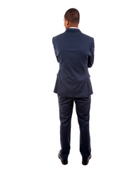 Young business man from the back over a white background