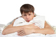 Man hugging pillow lying on bed