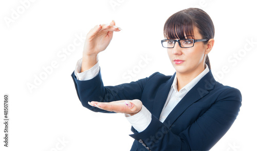 Businesswoman holding with her hands blank space