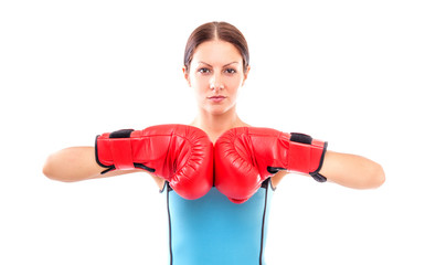Pretty girl in boxing gloves pose, isolated on white