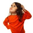 portrait brunette kid orange sweater, scratching his head thinki