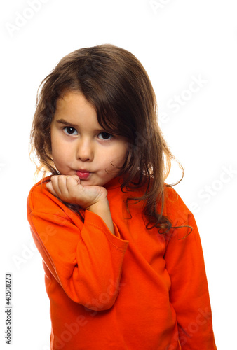 portrait of curly brunette girl child orange sweater flirt flirt