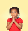 Sad little girl praying for something
