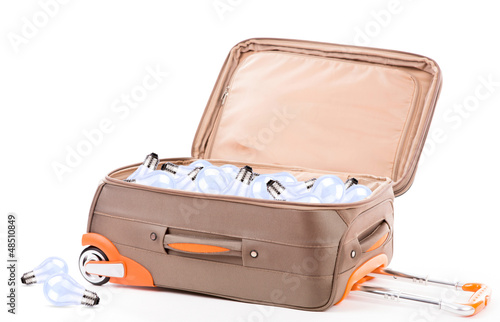 Suitcase and light bulb  isolated on a white background