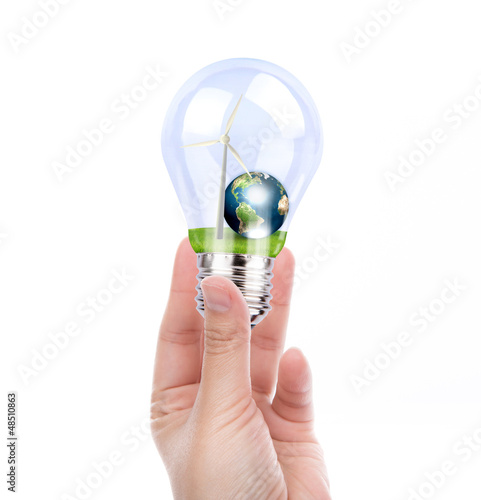 Hand holding light bulb with wind turbine and earth inside (Elem