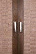 brown wooden closet doors with handles