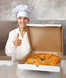 female cook with  pizza at kitchen