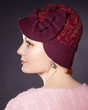 woman wearing dark red painted felt hat in retro stlyle