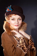 elegant woman wearing dark felt hat in retro style and fur