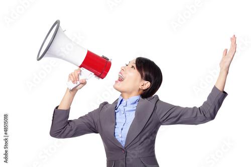 Business woman screaming in megaphone