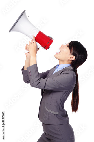 Business woman screaming in megaphone