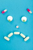 Sad smileyface made of pills