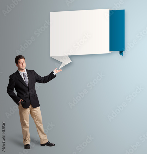 attractive man presenting modern origami copy space