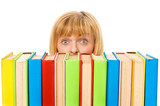 Surprised girl with stack color books. Isolated