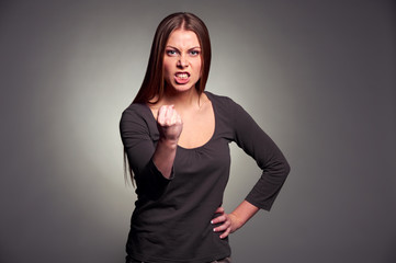 angry woman threatening the fist