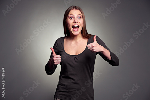 excited woman showing thumbs up