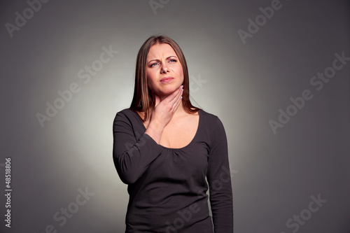woman have a throat pain
