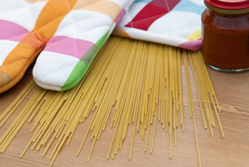 Italian spaghetti with potholder on the table