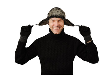Smiling man in black dressed in warm clothes and cap with ear-fl