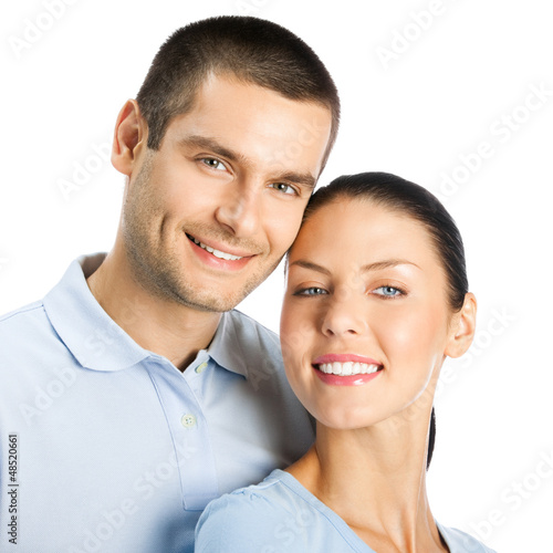 Happy smiling young couple, on white