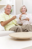 Senior Man & Woman Drinking Tea Coffee at Home