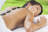 Woman Relaxing Health Spa Stone Treatment Massage