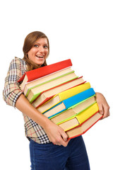 Teenage girl struggling with stack of books