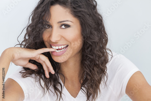 Beautiful Happy Woman Smiling Biting Finger