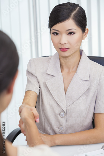 Asian Chinese Woman or Businesswoman Shaking Hands