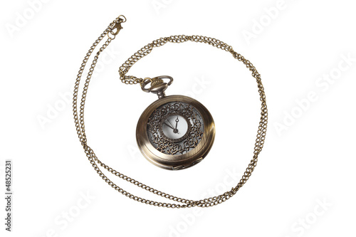 elegant pocket watch with the lid closed on a white background