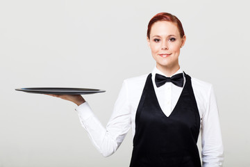 pretty waitress with an empty tray