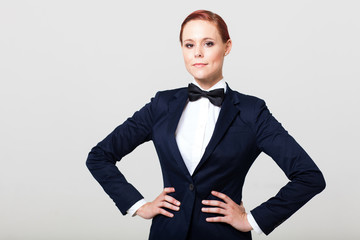 pretty fashion woman in suit with bow tie