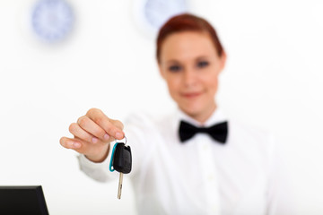 car rental company employee hand over car key to client