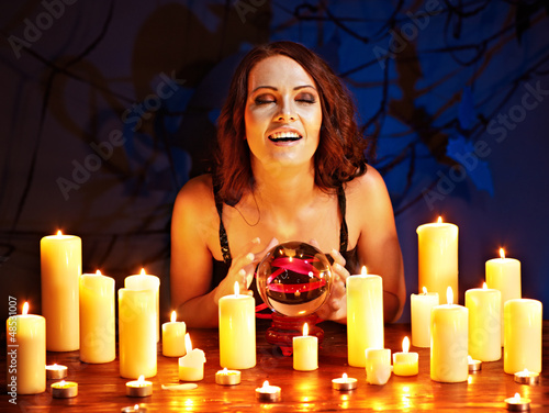 Woman holding scrying ball .