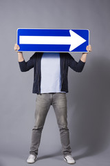 Man holding horizontal direction arrow sign.