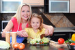 Mother and daughter cooking dinner in kitchen