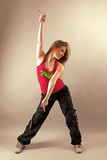 Young female dancing zumba fitness in studio