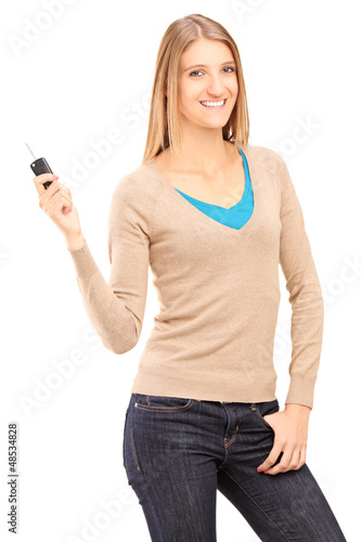 Satisfied young female holding a car key