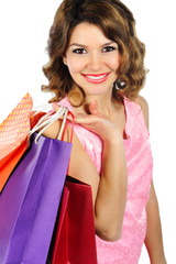 Young beautifil woman with colorful shopping bags isolated on wh