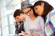 Students using smartphones at school